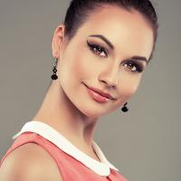 Close-up of pretty female model wearing jewelery