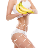 Young sexy woman in sporty clothes with bananas (healthy eating, vitamins and nutrition concept).
