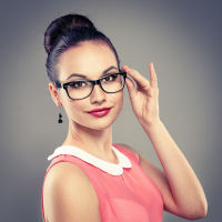 Fashionable woman with professional hairdo in eyeglasses