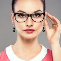 Young pretty female touching her optical eyeglasses